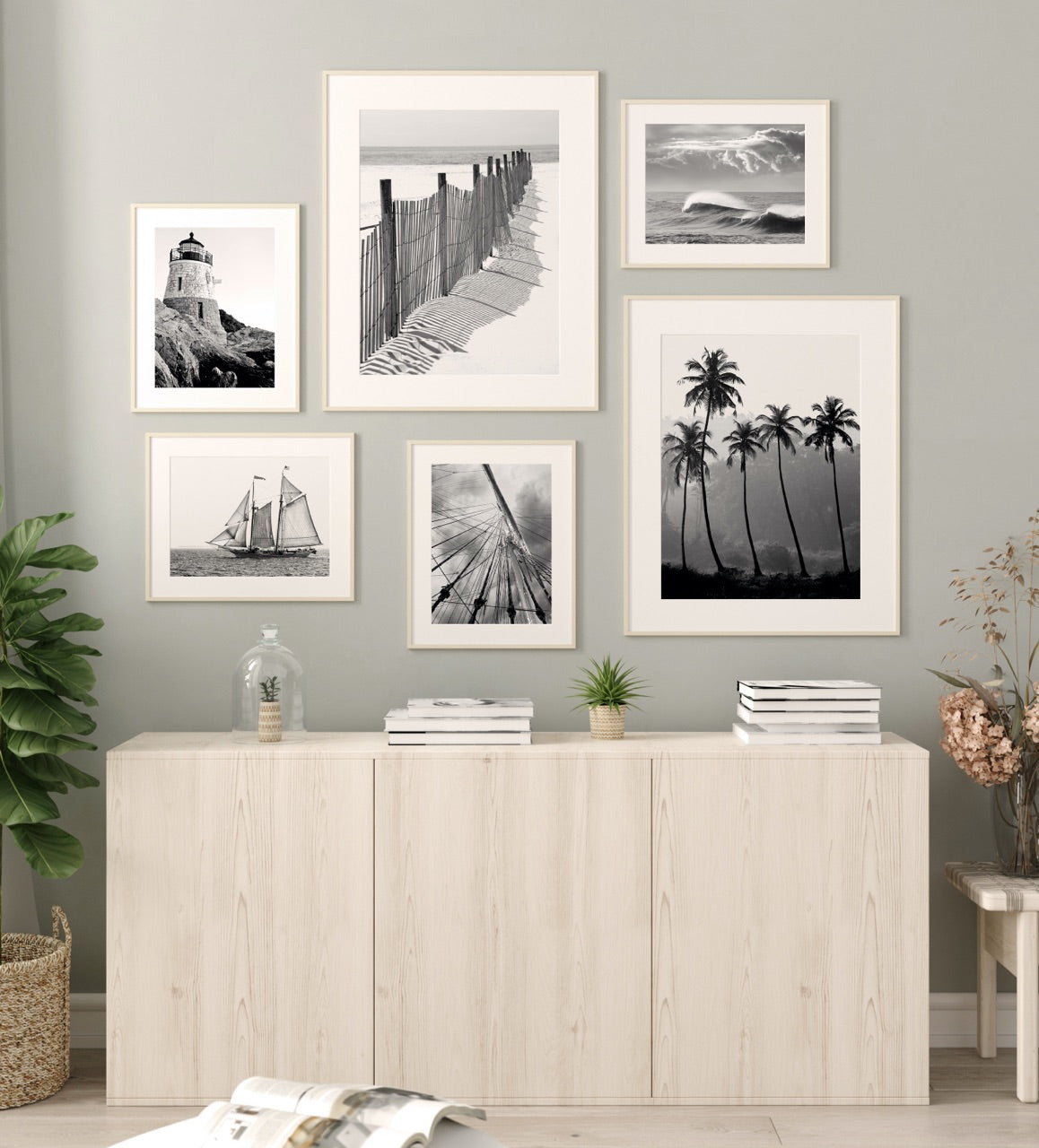 Gallery wall with framed black and white beach prints