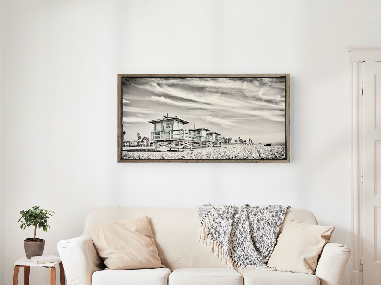 Framed beach photograph in living room