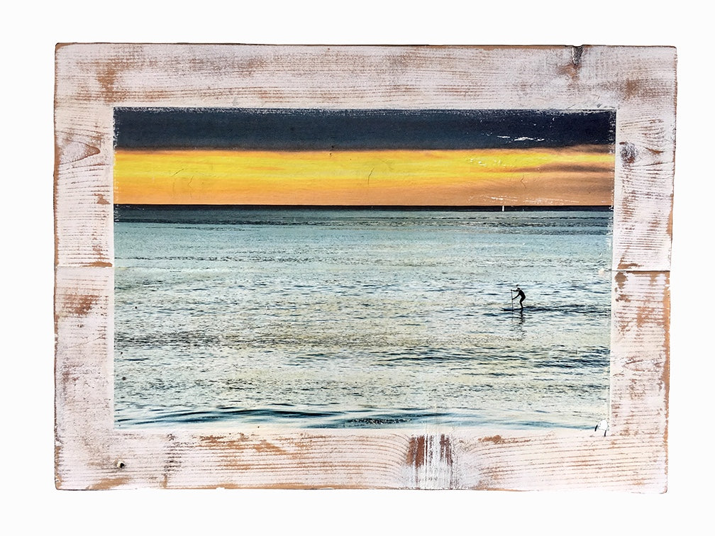 Wood photo art of a paddle boarder on the ocean