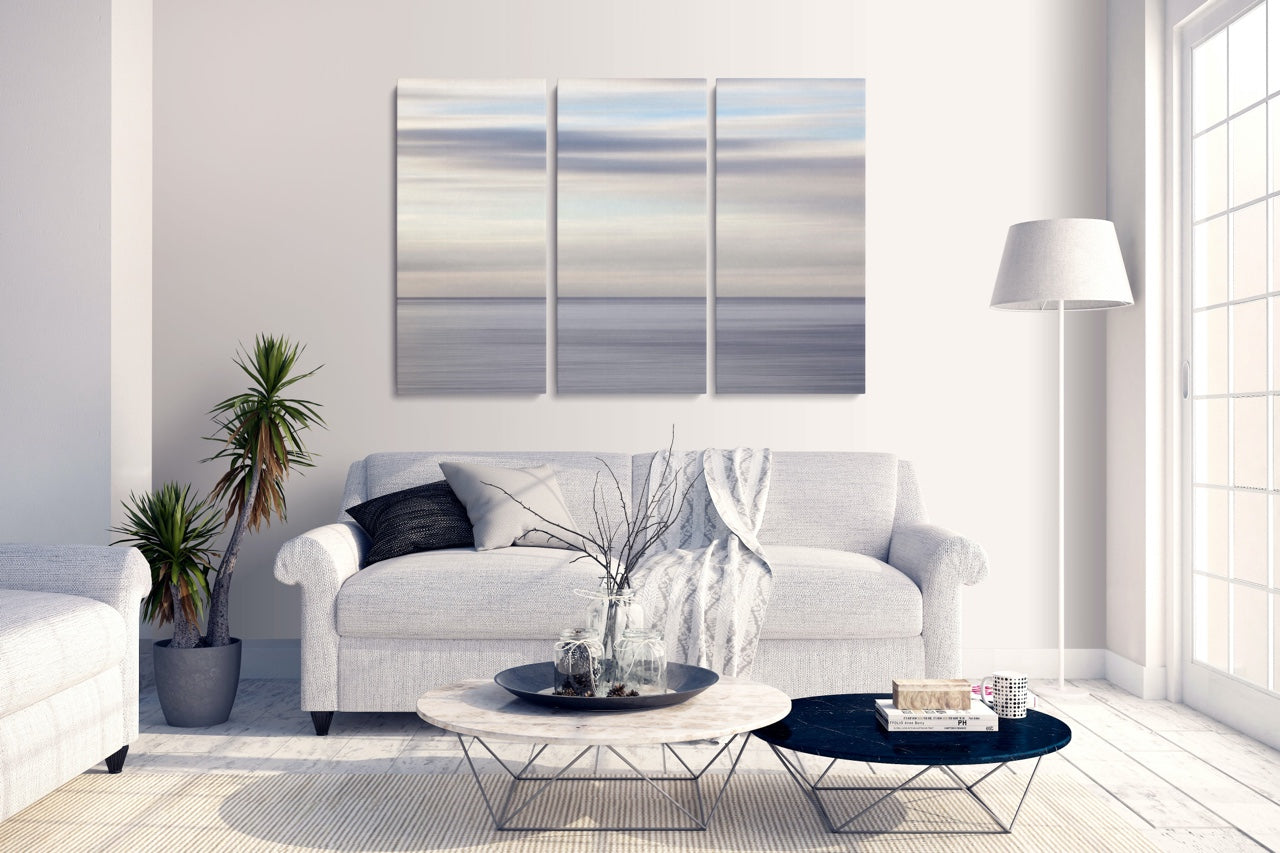 Abstract ocean triptych art in modern living room