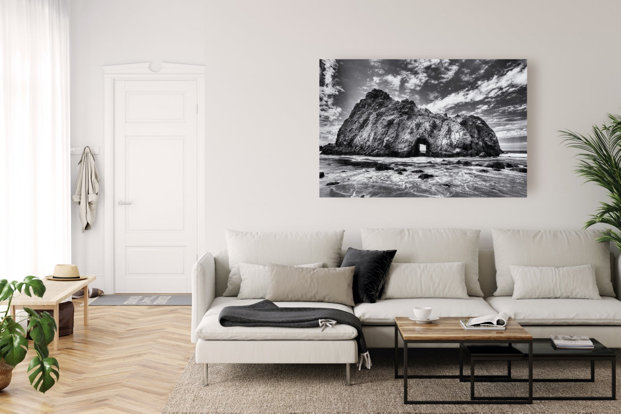Modern living room with black and white beach wall art