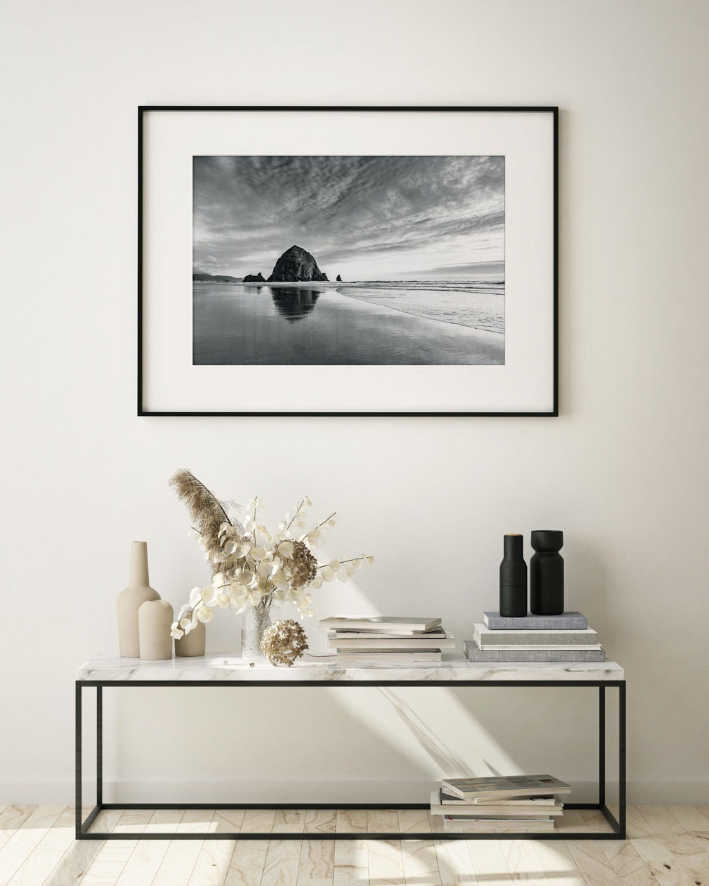 Modern entryway with a large framed beach photograph
