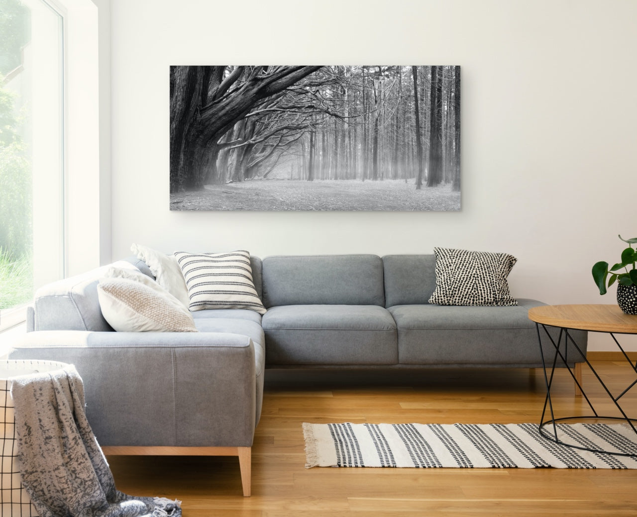 Black and white forest wall art in modern living room