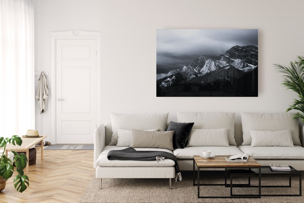 Minimalist living room with large black landscape photograph