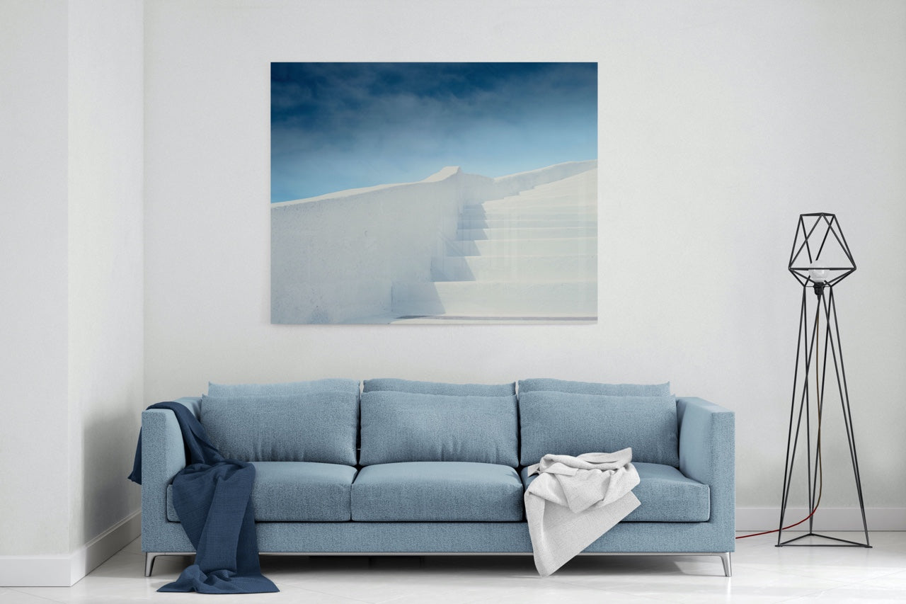 Abstract blue and white abstract wall art over a sofa