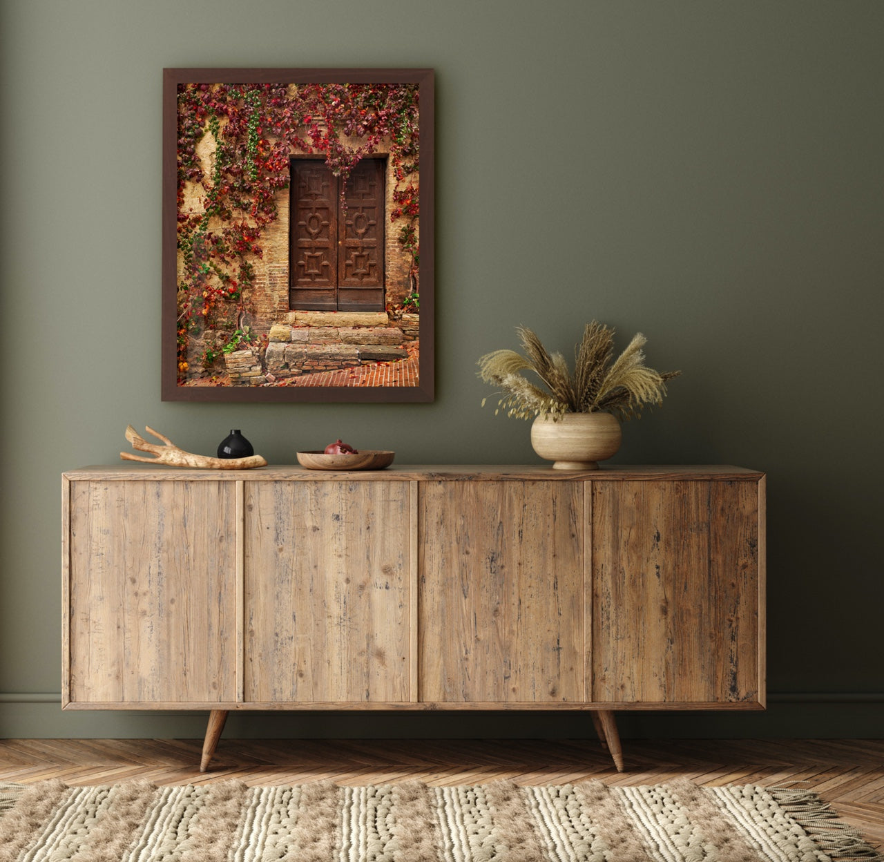 Framed photography with fall leaves over dresser