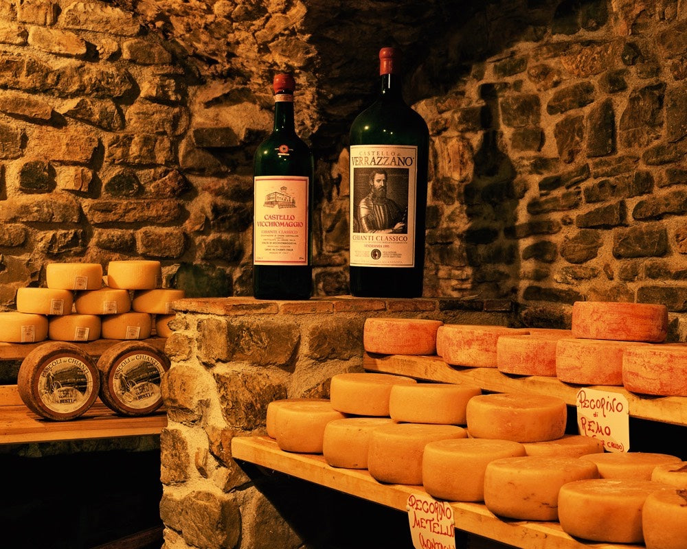 Photograph of a cellar with cheese and wine