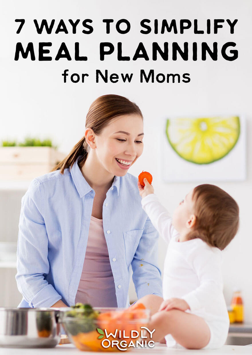Photo of Mom and Toddler in the kitchen eating veggies | 7 Ways to Simplify Meal Planning for New Moms | Seven ways to simplify meal planning to allow you to spend less time stressing in the kitchen and more time focusing on your family. #mealplan #mealprep #realfood #easyrecipes #healthyliving #healthylife #newmom