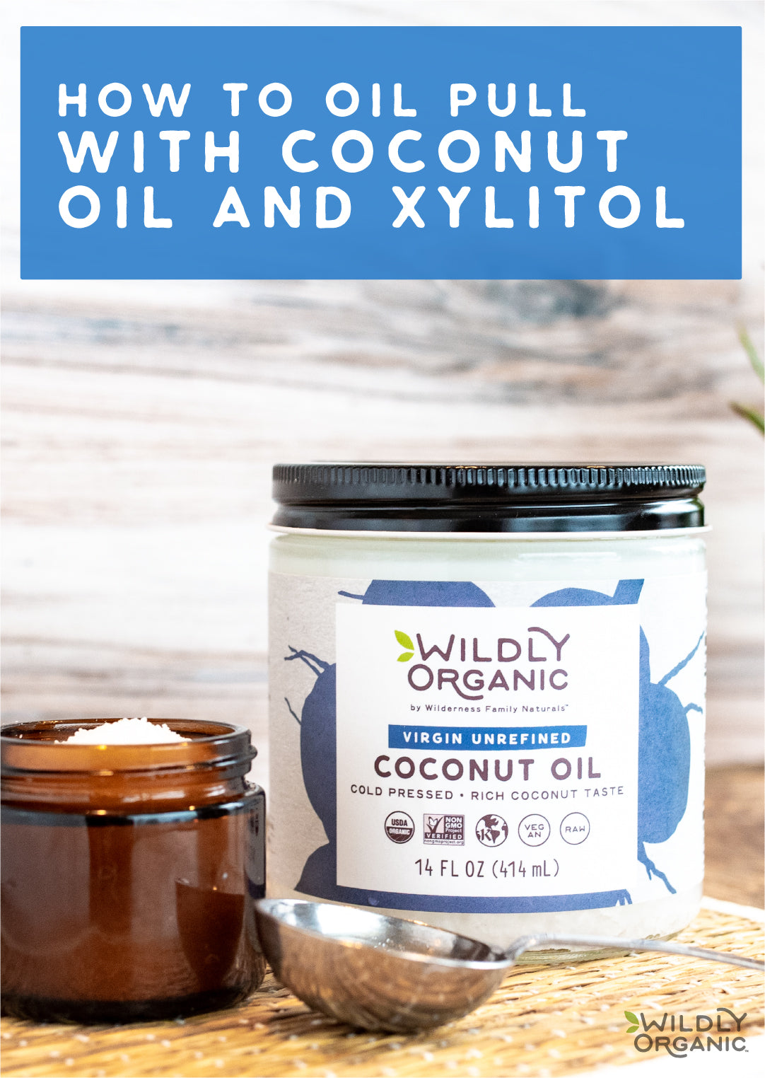 Jar of Wildly Organic Cold Pressed Coconut oil with metal scoop on wooden counter top