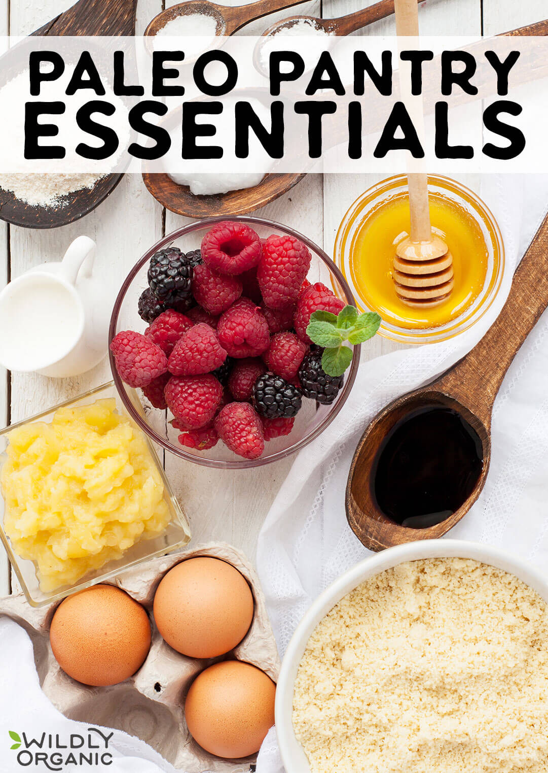 Photo of different paleo pantry essentials in bowls and on spoons – almond flour, coconut flour, honey, coconut oil