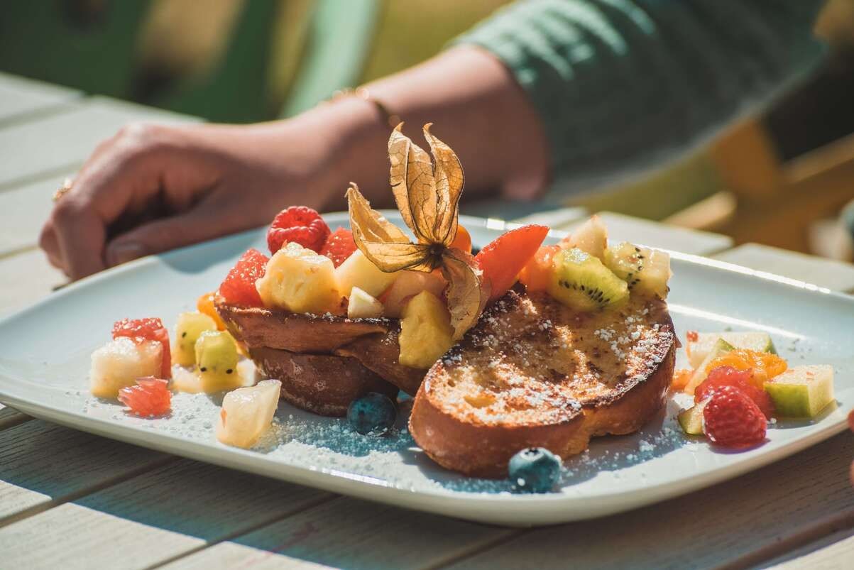 French toast topped with fresh fruit pieces