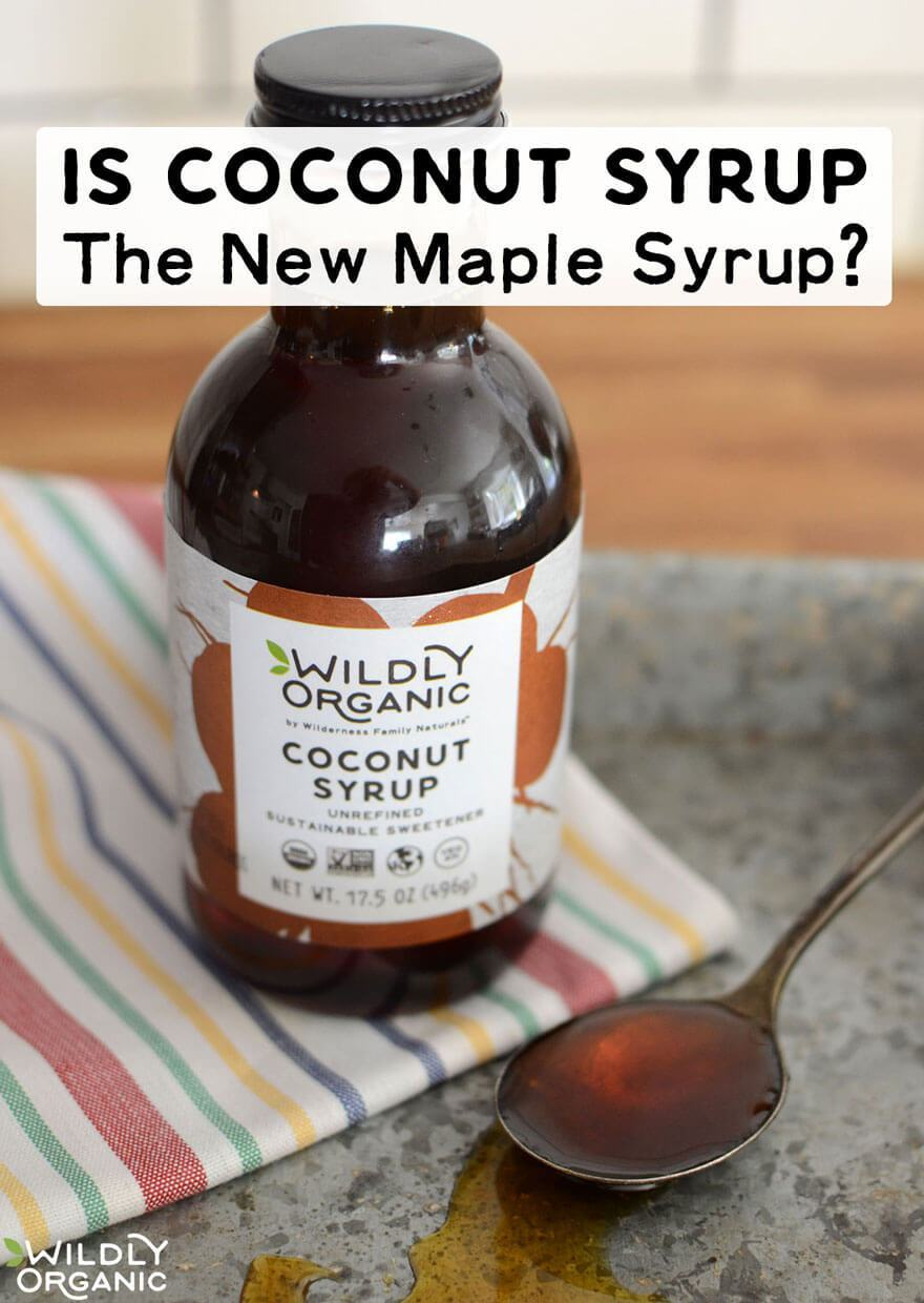 A bottle of Wildly Organic Coconut Syrup alongside a spoonful of nectar
