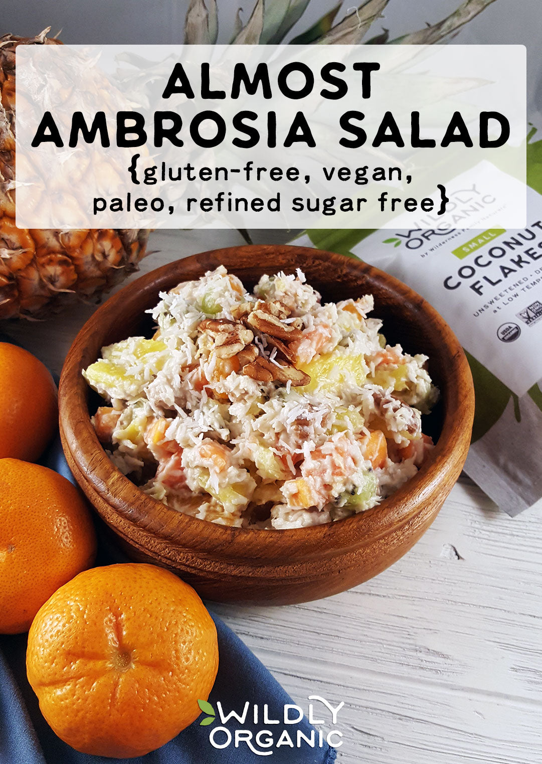 A photo of ambrosia salad with pecans in a bowl.