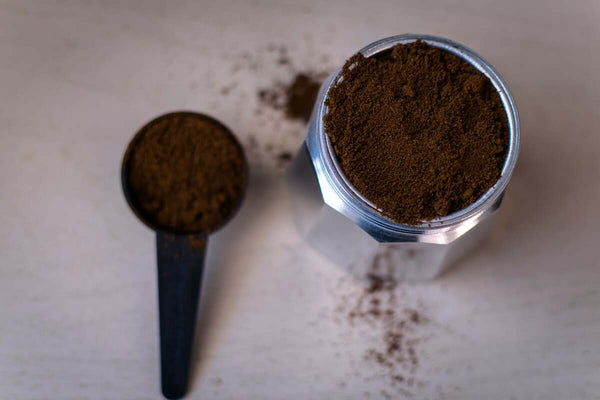 Brown powder in a glass jar and scoop