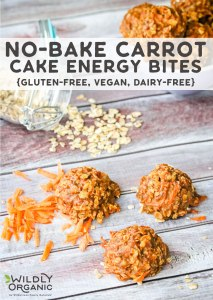 A vertical photo of no-bake carrot cake energy bites with shredded carrots and a jar of gluten-free oats.