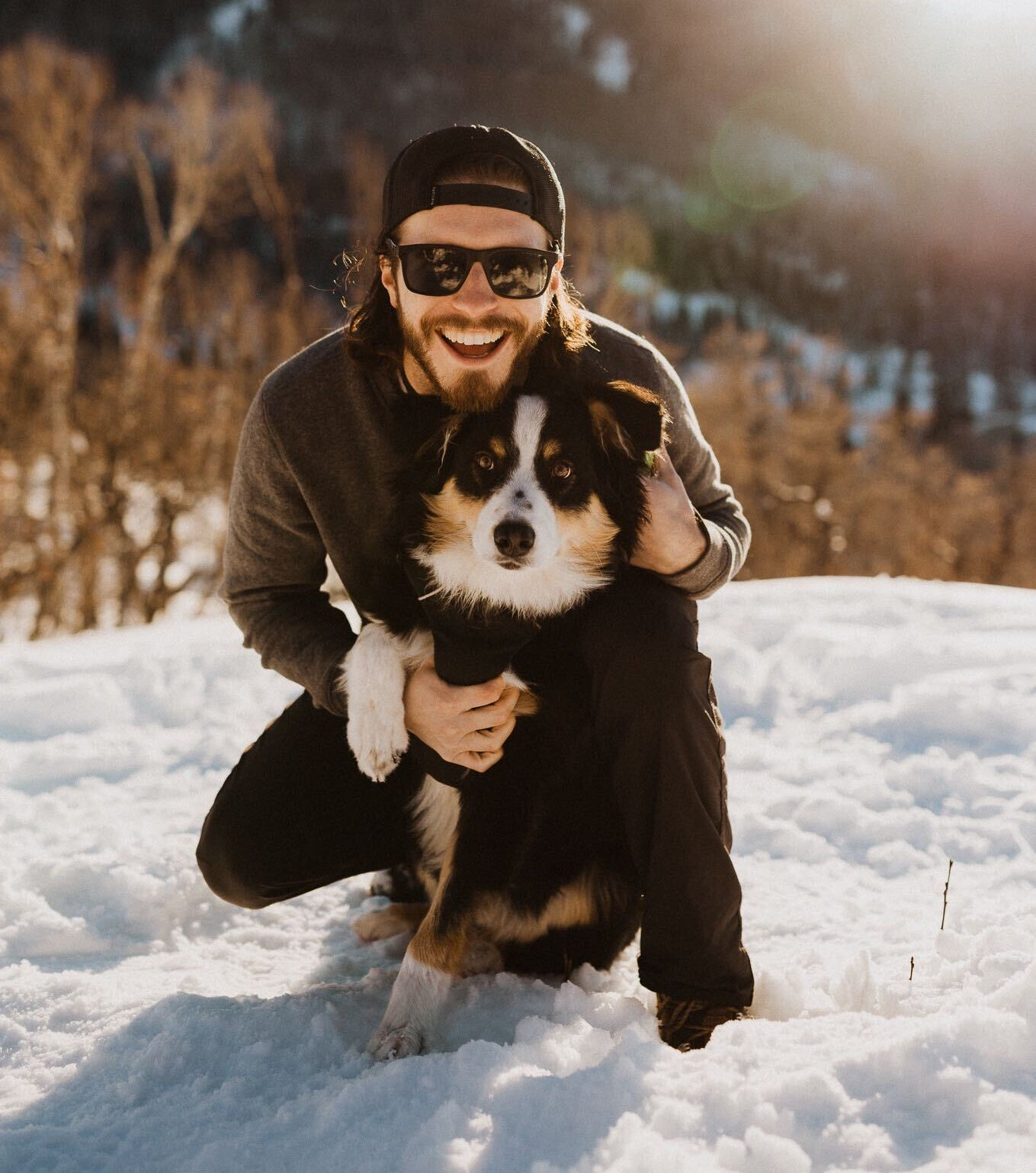 atlas pet company travis danforth and denali posing on the about us page