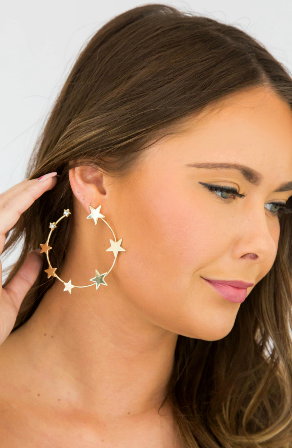 Dancing Under Stars Gold Crystal Star Hoops