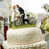 couple, pedal, pedal, bike, bicycle, basket, husband, wife, bride, groom, bride and groom, cake, cake topper, topper, hand painted, hand-painted, porcelain, hair color, wedding, reception, wedding reception, figurine