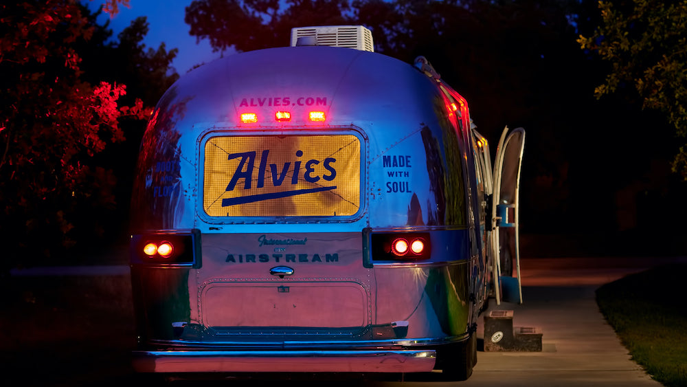 Alvies Airstream trailer selling boots and flip-flops, dusk