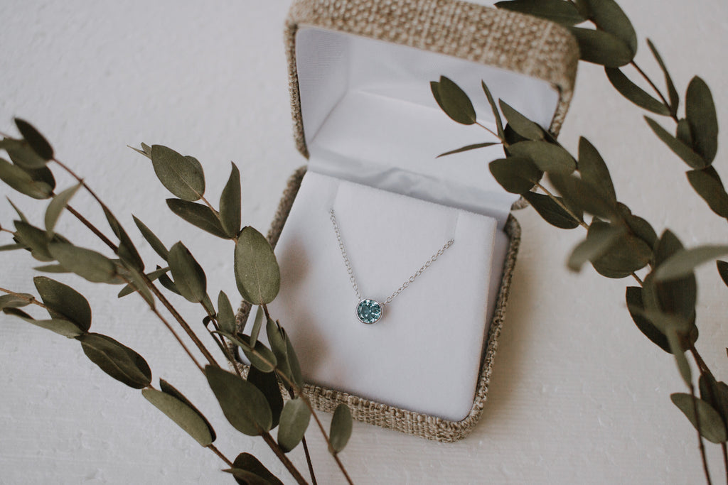 livlov bespoke 14k white gold and blue topaz engagement necklace