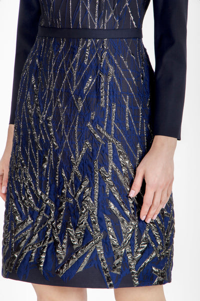 Blue evening dress with metallic details