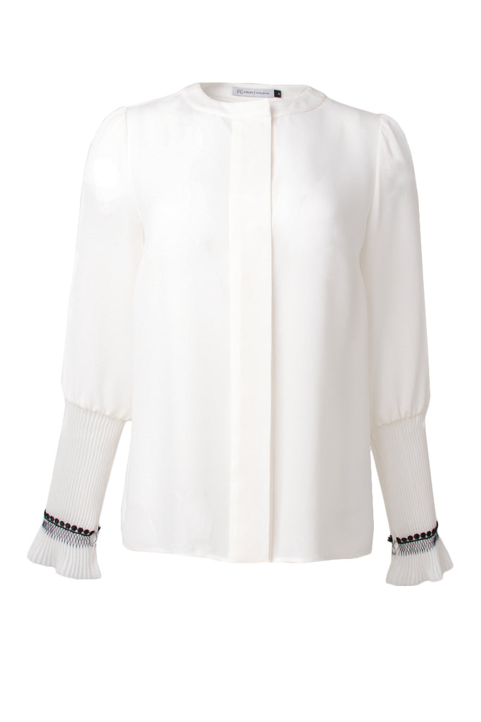 White silk blouse with gathered sleeves