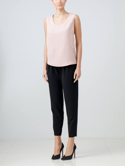 Light pink sleeveless asymmetric blouse