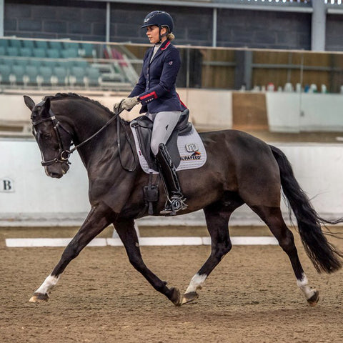 Dressage rider Laura Fisher sponsored by Snuggy Hoods Ltd
