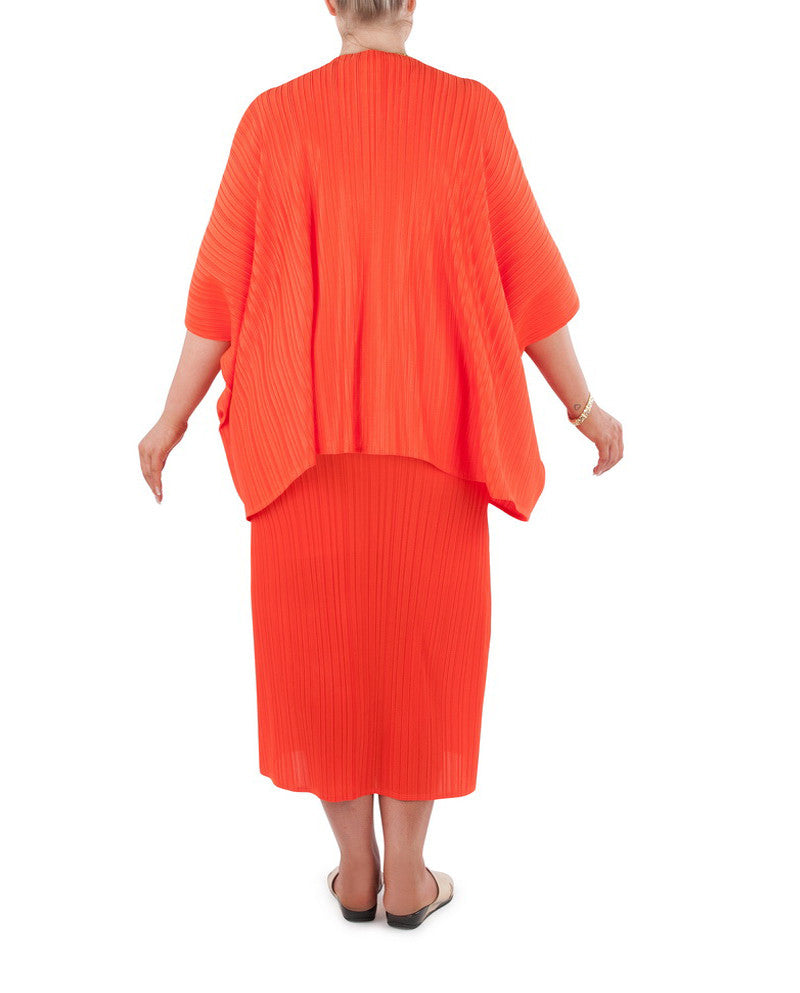 "A cover-up that will add confidence and glamour, adding a finishing touch to that special outfit or just that little extra warmth on a cool day or evening Team with a Coral & Co Mid-length or Long dress, Long Line Tunic Top, Box Tee or one of our luxurious Silk Scarves, for the colour coordinated Coral & Co Look.  Oversized style, cut to be worn loose. Elbow length sleeve, Centre opening. Length from shoulder to hem approx. 28 1/4"" / 72cm. Body Contouring Slimline permanent micro pleating.  Fabric: 100% Permanent Pleated Polyester Knit, Machine Washable, Non-iron. Country of Origin: China / Australia. Designed and Made in Australia.  Model is 173cm/5'8"" and is wearing a size 16.  Product Code: CWS16J0002-35"