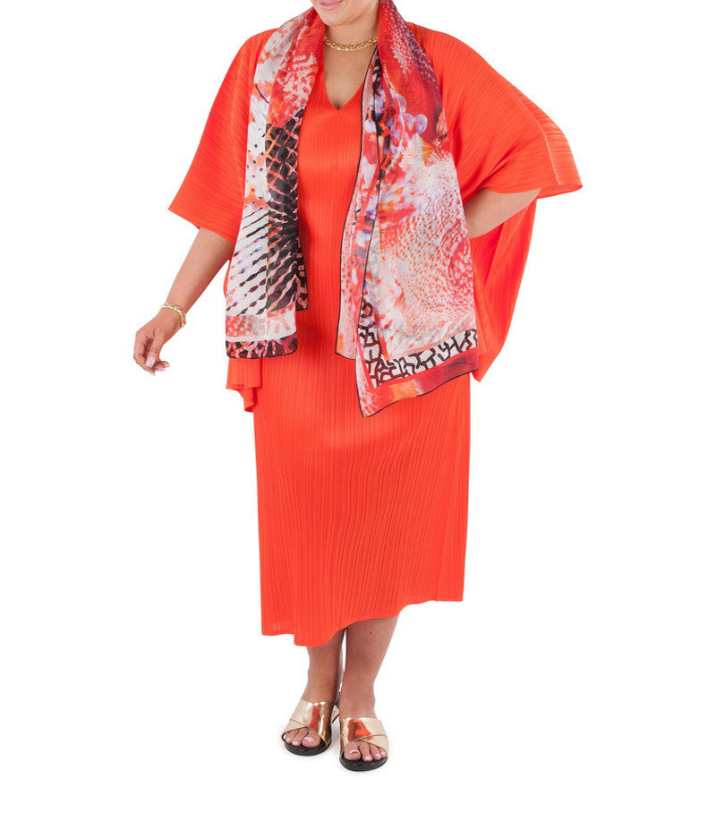 "This long line dress is an essential addition to any wardrobe.  Dress it up for the special occasion or evening event; dress down for the office or travel. Designed for the modern busy woman, a dress that will carry you comfortably through the day into evening. Team with a Coral & Co Kimono Jacket, Slimline Long Sleeveless Jacket or Skirt and one of our luxurious Silk Scarves, for the color coordinated Coral & Co Look.  Relaxed fit long length dress Low cut V neck and extended cap sleeve Length from shoulder to hem approx. 53""/ 135cm. Body Contouring Slimline permanent micro pleating.  Fabric: 100% Permanent Pleated Polyester Knit, Machine Washable, Non iron.  Country of Origin: China / Australia Designed and Made in Australia.  Model is 172cm/5'7.5"" tall: Bust: 105cm/41.5"", Waist: 90cm/35.5"", Hips: 115cm/45.5"" and is wearing a size 16.  Product Code: CWS16D0002L-35"