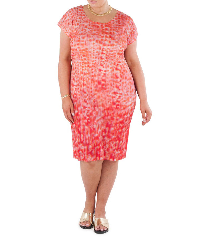 "The delicate hues of coral bring a soft gentle glow to this sophisticated and versatile below knee length dress.  Designed for the modern busy woman, a dress that will carry you comfortably through the day into evening  MIx & Match with a Coral and Co Kimono Jacket, Slimline Long Sleeveless Jacket or Skirt and one of our luxurious Silk Scarves, for the color coordinated Coral & Co Look.  Relaxed fit mid length dress.  Flattering scooped neckline and extended cap sleeve.  Length from shoulder to hem approx. 42 1/2"" / 108cm.  Body Contouring Slimline permanent micro pleating.  Fabric: 100% Permanent Pleated Polyester Knit, Machine Washable, Non-iron.  Country of Origin: China / Australia.  Designed and Made in Australia.    Model is 173cm/5'8"" and is wearing a size 16. Product Code: CWS16D0001M-3235"