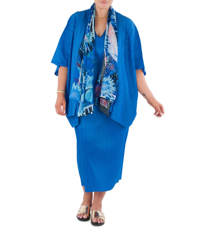 "This long line dress is an essential addition to any wardrobe.  Dress it up for the special occasion or evening event; dress down for the office or travel. Designed for the modern busy woman, a dress that will carry you comfortably through the day into evening. Team with a Coral & Co Kimono Jacket, Slimline Long Sleeveless Jacket or Skirt and one of our luxurious Silk Scarves, for the color coordinated Coral & Co Look.  Relaxed fit long length dress Low cut V neck and extended cap sleeve Length from shoulder to hem approx. 53""/ 135cm. Body Contouring Slimline permanent micro pleating.  Fabric: 100% Permanent Pleated Polyester Knit, Machine Washable, Non iron.  Country of Origin: China / Australia Designed and Made in Australia.  Model is 172cm/5'7.5"" tall: Bust: 105cm/41.5"", Waist: 90cm/35.5"", Hips: 115cm/45.5"" and is wearing a size 16.  Product Code: CWS16D0002L-75"