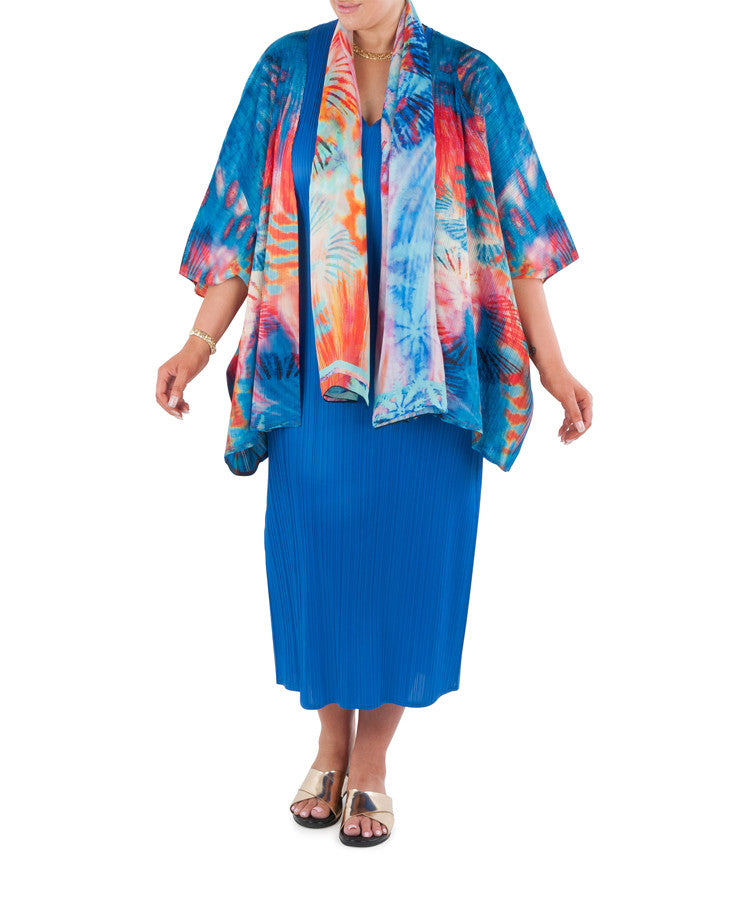 "Stand out in the crowd in this statement piece. The pattern reflecting the kaleidoscope of color, texture and form, as the setting sun spreads its fire across the tropical waters of Australia's Great Barrier Reef.   A cover-up that will add glamour, a finishing touch to that special outfit, day or evening.   Try teaming with a Coral & Co Mid-length or Long dress, Long Line Top, Box Tee or one of our luxurious Silk Scarves, for the color coordinated Coral & Co Look.  Oversized style, cut to be worn loose.  Elbow length sleeve, Centre opening.  Length from shoulder to hem approx. 28 1/4"" / 72cm.  Body Contouring Slimline permanent micro pleating.  Fabric: 100% Permanent Pleated Polyester Knit, Machine Washable, Non-iron.  Country of Origin: China / Australia.  Designed and Made in Australia.  Model is 172cm/5'7.5"" tall: Bust: 105cm/41.5"", Waist: 90cm/35.5"", Hips: 115cm/45.5""  and is wearing a size M. Product Code: CWS16J0002-7535"