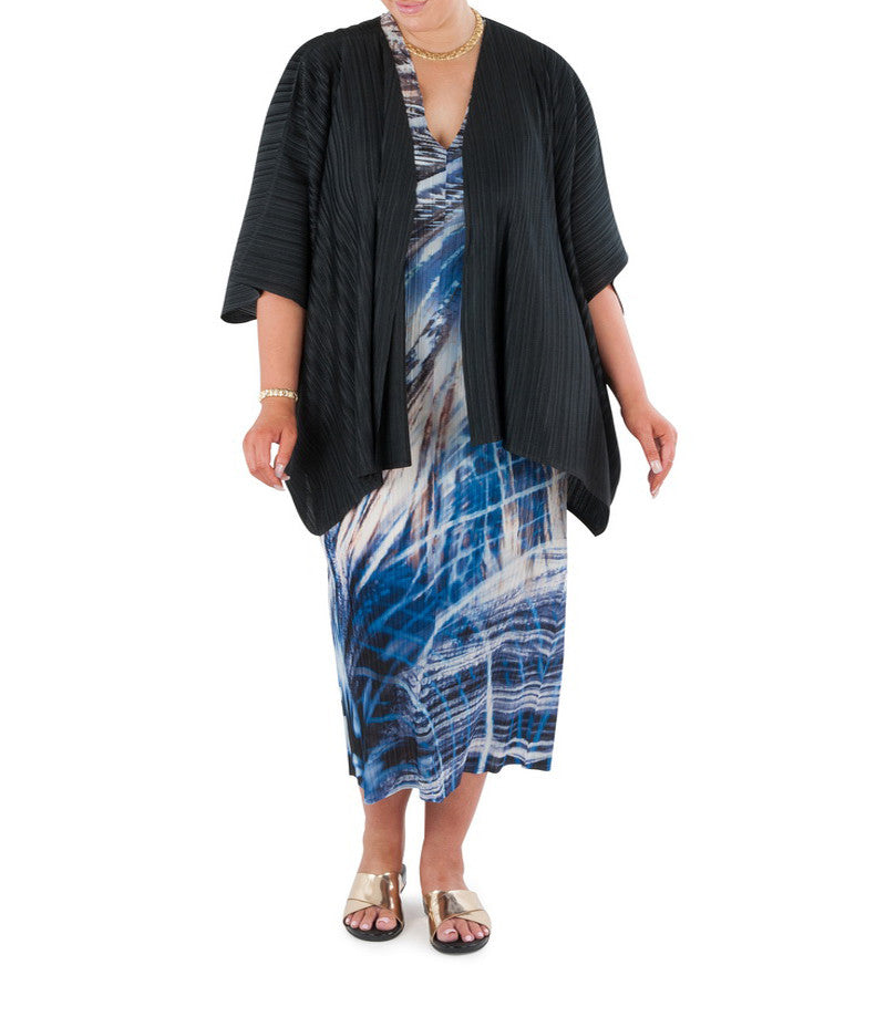 "This elegant piece brings together all the diversity of form, freshness and play of light and dark that is Australia's tropical water wonderland.  Designed for the modern busy woman, a dress that will carry you comfortably through the day into evening.  Try teaming with a matching Coral & Co Kimono Jacket or matching luxurious Silk Scarf, for the color coordinated Coral & Co Look.     Relaxed fit long length dress in pleated knit fabric.  Low cut V neck and extended cap sleeve.  Length from shoulder to hem approx. 53"" / 135.  Body Contouring Slimline permanent micro pleating.     Fabric: 100% Permanent Pleated Polyester Knit, Machine Washable, Non-iron.  Country of Origin: China / Australia.  Designed and Made in Australia.  Model is 172cm/5'7.5"" tall: Bust: 105cm/41.5"", Waist: 90cm/35.5"", Hips: 115cm/45.5""  and is wearing a size 16."