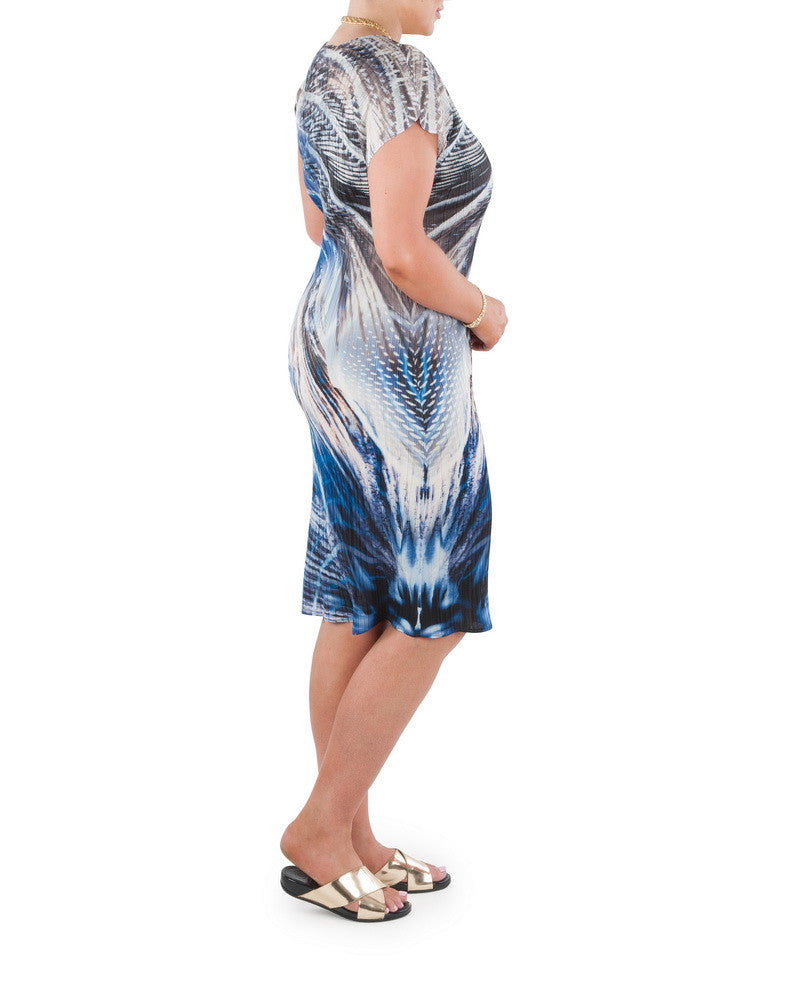 "Brighten up your day or evening with this elegant and sophisticated dress which brings together all the diversity of form, freshness and play of light and dark that is Australia's tropical water wonderland.   Designed for the modern busy woman, a dress that will carry you comfortably through the day into evening.   Team with a Coral and Co Kimono Jacket, Slimline Long Sleeveless Jacket or Skirt and luxurious Silk Scarf, for the color coordinated Coral & Co Look.   Relaxed fit mid length dress.  Flattering scooped neckline and extended cap sleeve.  Length from shoulder to hem approx. 42 1/2"" / 108cm.  Body Contouring Slimline permanent micro pleating.  Fabric: 100% Permanent Pleated Polyester Knit, Machine Washable, Non-iron.  Country of Origin: China / Australia.  Designed and Made in Australia.   Model is 173cm/ 5'8"" and is wearing a size 16.  Product Code: CWS16D0001M-0010"