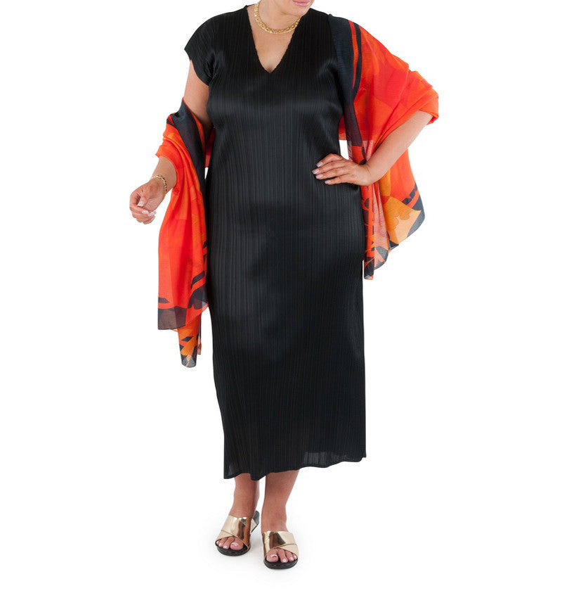 "This long line dress is an essential addition to any wardrobe.  Dress it up for the special occasion or evening event; dress down for the office or travel. Designed for the modern busy woman, a dress that will carry you comfortably through the day into evening. Team with a Coral & Co Kimono Jacket, Slimline Long Sleeveless Jacket or Skirt and one of our luxurious Silk Scarves, for the color coordinated Coral & Co Look.  Relaxed fit long length dress Low cut V neck and extended cap sleeve Length from shoulder to hem approx. 53""/ 135cm. Body Contouring Slimline permanent micro pleating.  Fabric: 100% Permanent Pleated Polyester Knit, Machine Washable, Non iron.  Country of Origin: China / Australia Designed and Made in Australia.  Model is 172cm/5'7.5"" tall: Bust: 105cm/41.5"", Waist: 90cm/35.5"", Hips: 115cm/45.5"" and is wearing a size 16.  Product Code: CWS16D0002L-00"