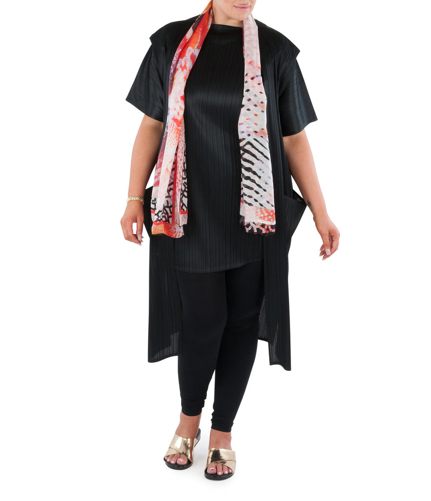 "This Long Line Tunic Top is an essential addition to any wardrobe. Versatile and stylish; pair with pants, leggings or a long skirt.  Team with a Coral & Co Kimono Jacket, Slimline Long Jacket or Skirt and luxurious Silk Scarf for the color coordinated Coral & Co Look.  Relaxed fit Long Line Top style top. Beautiful soft boat neck Long Line Top with short sleeves. Length from shoulder to hem approx. 34""/ 86cm. Body Contouring Slimline permanent micro pleating.  Fabric: 100% Permanent Pleated Polyester Knit, Machine Washable, Non-iron.  Country of Origin: China / Australia. Designed and Made in Australia.  Model is 172cm/5'7.5"" tall: Bust: 105cm/41.5"", Waist: 90cm/35.5"", Hips: 115cm/45.5"" and is wearing a size 16.  Leggings models own.  Product Code: CWS16O0001-00"