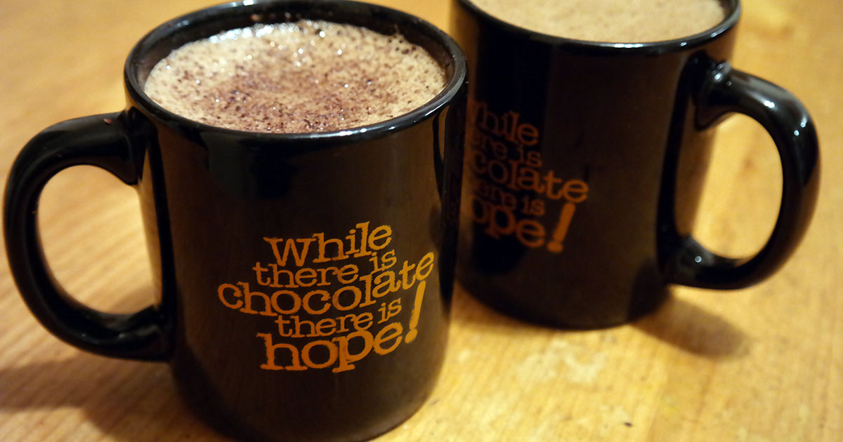 while there is chocolate there is hope mugs