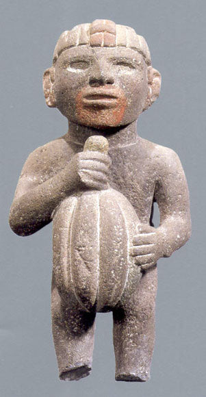 statue of man holding cacao pod