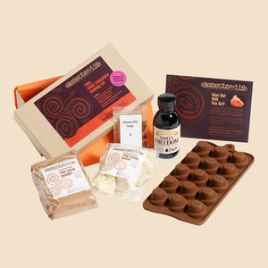 Raw chilli chocolate making kit contents, with swirls mould