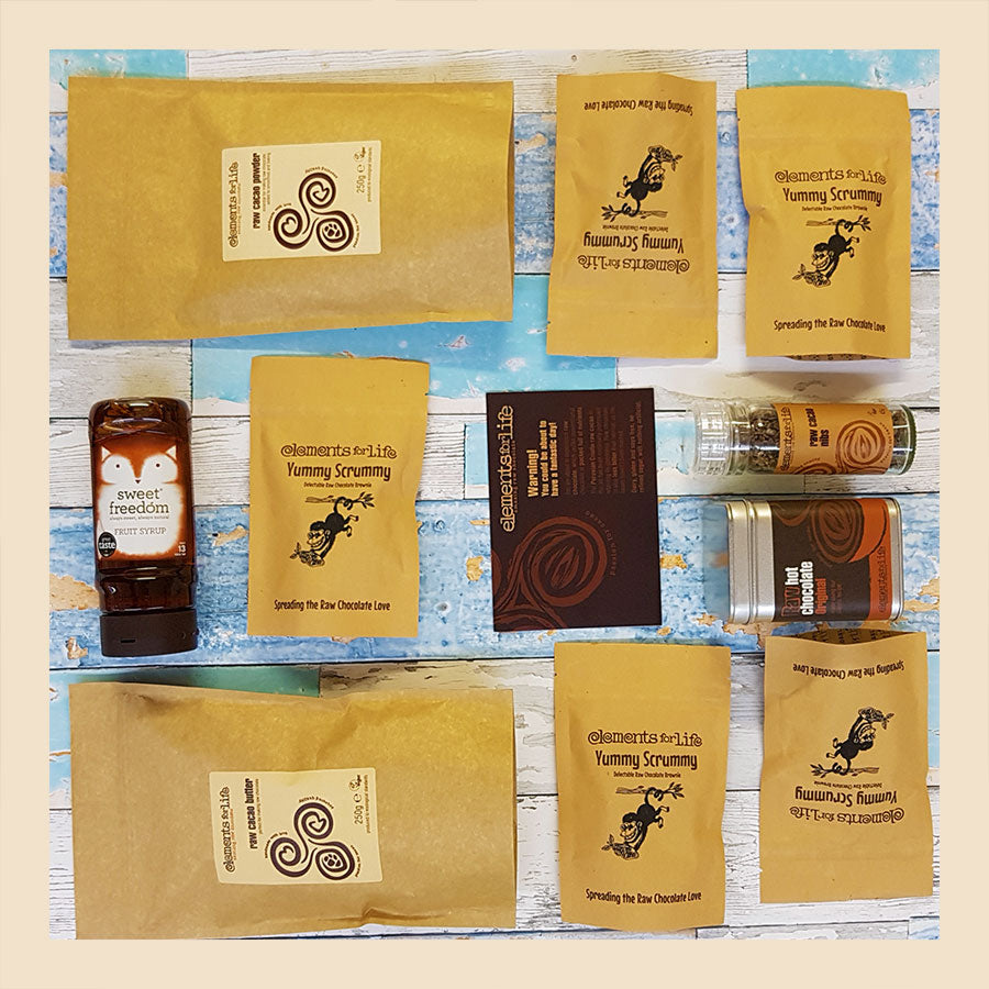raw chocolate explorer hamper flatlay