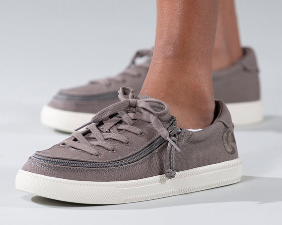 Kid's Dark Grey BILLY Classic Lace Lows, zipper shoes, like velcro, that are adaptive, accessible, inclusive and use universal design to accommodate an afo. Footwear is medium and wide width, M, D and EEE, are comfortable, and come in toddler, kids, mens, and womens sizing.