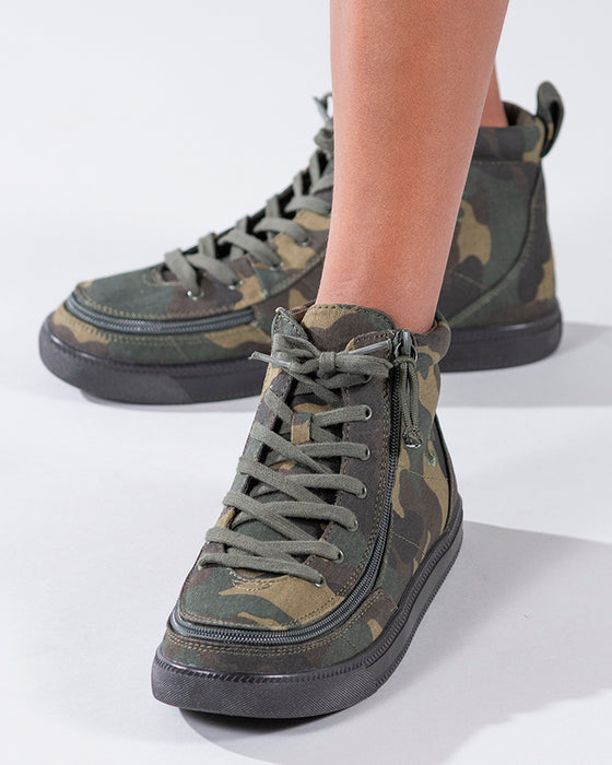 Kid's Green Camo BILLY Classic Lace Highs, zipper shoes, like velcro, that are adaptive, accessible, inclusive and use universal design to accommodate an afo. Footwear is medium and wide width, M, D and EEE, are comfortable, and come in toddler, kids, mens, and womens sizing.