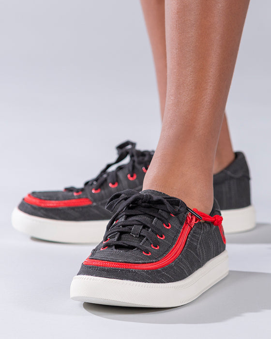 Kid's Black/Red BILLY Classic Lace Lows, zipper shoes, like velcro, that are adaptive, accessible, inclusive and use universal design to accommodate an afo. Footwear is medium and wide width, M, D and EEE, are comfortable, and come in toddler, kids, mens, and womens sizing.