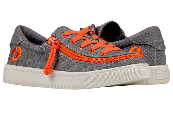 Kid's Grey/Orange BILLY Classic Lace Lows, zipper shoes, like velcro, that are adaptive, accessible, inclusive and use universal design to accommodate an afo. Footwear is medium and wide width, M, D and EEE, are comfortable, and come in toddler, kids, mens, and womens sizing.