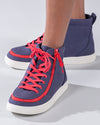Kid's Navy/Red BILLY Classic Lace Highs, zipper shoes, like velcro, that are adaptive, accessible, inclusive and use universal design to accommodate an afo. Footwear is medium and wide width, M, D and EEE, are comfortable, and come in toddler, kids, mens, and womens sizing.