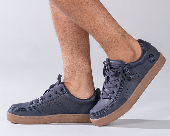 Men's Navy BILLY Sneaker Lows, zipper shoes, like velcro, that are adaptive, accessible, inclusive and use universal design to accommodate an afo. Footwear is medium and wide width, M, D and EEE, are comfortable, and come in toddler, kids, mens, and womens sizing.