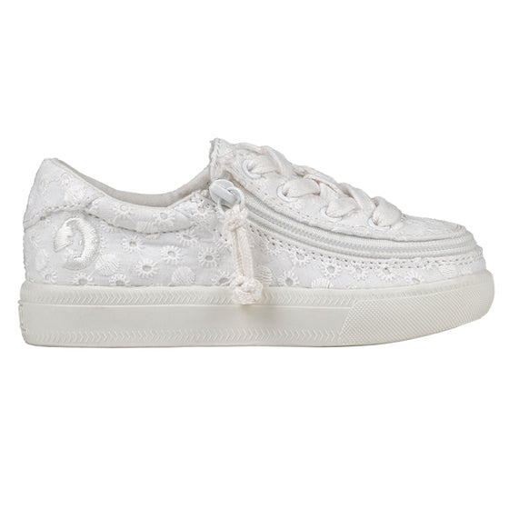 Toddler White Eyelet BILLY Classic Lace Lows, zipper shoes, like velcro, that are adaptive, accessible, inclusive and use universal design to accommodate an afo. Footwear is medium and wide width, M, D and EEE, are comfortable, and come in toddler, kids, mens, and womens sizing.