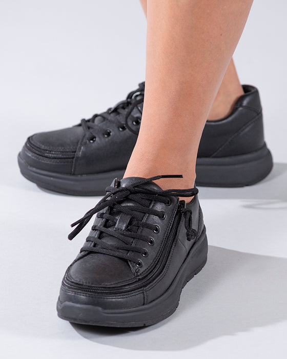 Women's Black to the Floor BILLY Work Comfort Lows, zipper shoes, like velcro, that are adaptive, accessible, inclusive and use universal design to accommodate an afo. Footwear is medium and wide width, M, D and EEE, are comfortable, and come in toddler, kids, mens, and womens sizing.
