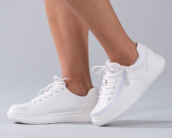 Women's White BILLY Work Comfort Lows, zipper shoes, like velcro, that are adaptive, accessible, inclusive and use universal design to accommodate an afo. Footwear is medium and wide width, M, D and EEE, are comfortable, and come in toddler, kids, mens, and womens sizing.